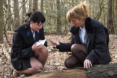 Forensic research. Two female police officers working on forensic research Royalty Free Stock Images