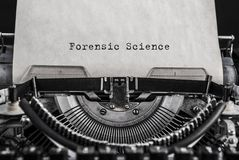 Forensic Science words typed on vintage typewriter. royalty free stock photos