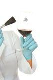 Forensic scientist dusting glass fingerprints Royalty Free Stock Image