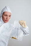 Forensic scientist securing. Female forensic scientist holding ammunition as evidence Stock Image