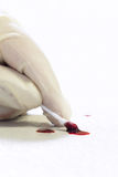 Forensics on crime scene, cotton swab and blood Stock Photo