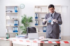The forensics investigator at the scene of office crime. Forensics investigator at the scene of office crime royalty free stock photo