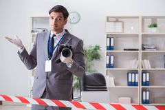 The forensics investigator at the scene of office crime. Forensics investigator at the scene of office crime stock photos