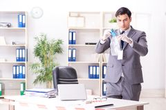 The forensics investigator at the scene of office crime. Forensics investigator at the scene of office crime stock image
