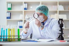 The forensics investigator working in lab on crime evidence. Forensics investigator working in lab on crime evidence royalty free stock photos