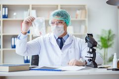 The forensics investigator working in lab on crime evidence. Forensics investigator working in lab on crime evidence royalty free stock photography