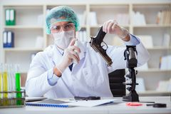 The forensics investigator working in lab on crime evidence. Forensics investigator working in lab on crime evidence stock images