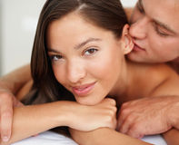 Foreplay: Honeymoon couple in bed Stock Photos