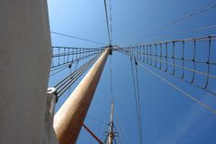 Foresail, Jib, and Wooden Mast of a sailing yacht Royalty Free Stock Image