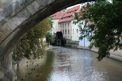 Foreshortening of the Devil's Channel in Prague with the old mill Royalty Free Stock Photo