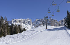 Ski run and chair lift at Rosengarten, Costalunga pass Stock Photo
