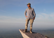Foresight. Me  on a rock  in the  guatemalan highlands, view to the pacific coast Stock Photo