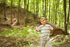 Forest. Cute kid outdoor in a forest Royalty Free Stock Photography