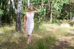 In forest. The woman posing in the forest Royalty Free Stock Photos