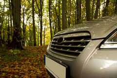 In the forest. Car parking in the autumn forest Stock Photos