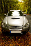In the forest. Car parking in the autumn forest Stock Images