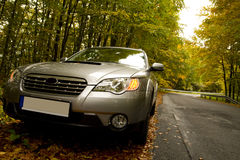 In the forest. Car parking in the autumn forest Royalty Free Stock Images