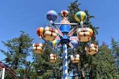 Forest Amusement Park. A Hot Air Baloon themed carnival ride in the forest Royalty Free Stock Photography