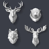 Forest animals on the wall. The heads of the forest animals are hanging on the wall. Head of white polygons. Abstract animals. The hunting trophies in the Royalty Free Stock Image