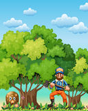 A forest with a bear and a lumberjack Stock Images