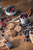 Forest berries and chocolate cookies. On the kitchen, cooking with forest berries,  chocolate, biscuits, and cookies. On the table, waiting for breakfest Stock Images