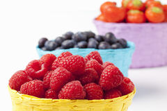Forest berries, raspberries, blueberries and strawberries in baskets. Closeup with selective focus Royalty Free Stock Photos