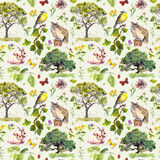 Forest: bird, rabbit, tree, leaves, flowers and grass. Seamless pattern. Watercolour. Forest - bird, rabbit, tree, leaves, flowers and grass Watercolour seamless Stock Photo