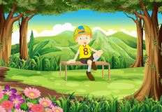A forest with a boy sitting above the table Stock Photography