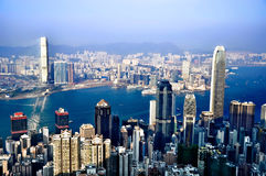The forest of buildings. Sightseeing of the skyline, forest of skyscrapers and building on the Victoria Harbor in Hong Kong on clear sunny day from above Royalty Free Stock Photography
