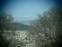 Blink and you`ll miss it. Forest/City/Mountains. Nepal has it all stock image