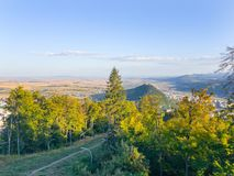 Forest and the city in valley. View of the forest and the city in Romania, Piatra Neamt Stock Image