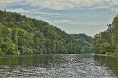 Forest coast near the Seversky Donets. Sviatohirsk, Ukraine. Shooting from the middle of the river Stock Photography