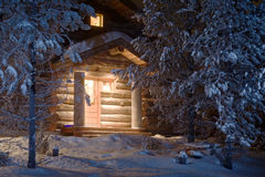 Forest cottage. Cozy wooden cottage in dark winter forest Royalty Free Stock Photos
