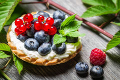 Forest cupcake with berry fruits. On old wooden table Royalty Free Stock Photo