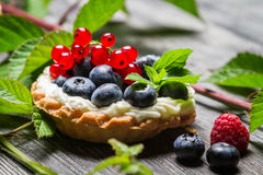 Forest cupcake with berry fruits. On old wooden table Royalty Free Stock Image