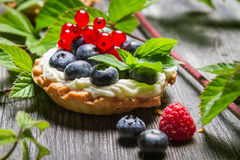 Forest cupcake with berry fruits. On old wooden table Royalty Free Stock Photography