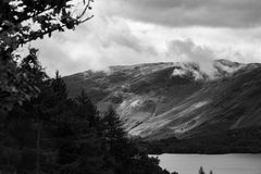 Forest and Derwent Water, Keswick, Lake District, UK- telephoto. Dramatic view of the forest and Lake Derwent Water in Keswick, Lake District, Cumbria, UK Stock Photos
