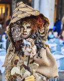 Forest Disguise - Venice Carnival 2014. Venice,Italy- March 2, 2014: A person disguised in a forest-like costume posing in San Marco Square during the Venice Stock Image