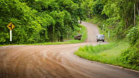 Into the forest. Drive a car on the off-road to forest in Thailand Stock Images