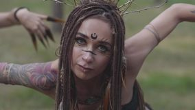Forest dwellers dancing in the woods hot dance, moving simultaneously, arching their bodies. Forest fairies, dryads in