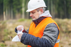 Forest engineer destroying sensitive documents in the forest Stock Photography