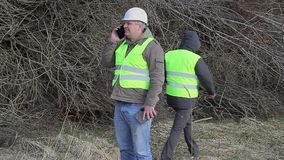 Forest engineers with cell phone andtablet PC stock video footage
