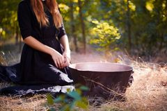 The forest enigmatic witch in the green wood outdoors. stock image