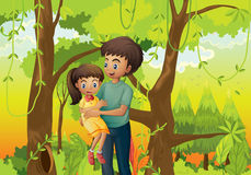 A forest with a father carrying his daughter Stock Image
