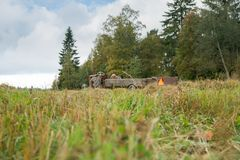 Forest and field landskape. Finnish forest and field landscape with tractor Stock Image