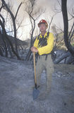 Forest fire fighter holding shovel Stock Photo