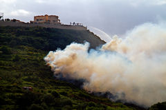 Forest fire. In Greece, fire department spraying water from a hotel on a hill royalty free stock photos