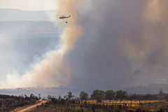 Forest fire and helicopter. Helicopter and forest fire with huge smoke stock images