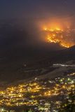 Forest fire near the town. Forest fire in mountains near the town Royalty Free Stock Images