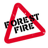 Forest Fire rubber stamp. Grunge design with dust scratches. Effects can be easily removed for a clean, crisp look. Color is easily changed Royalty Free Stock Images